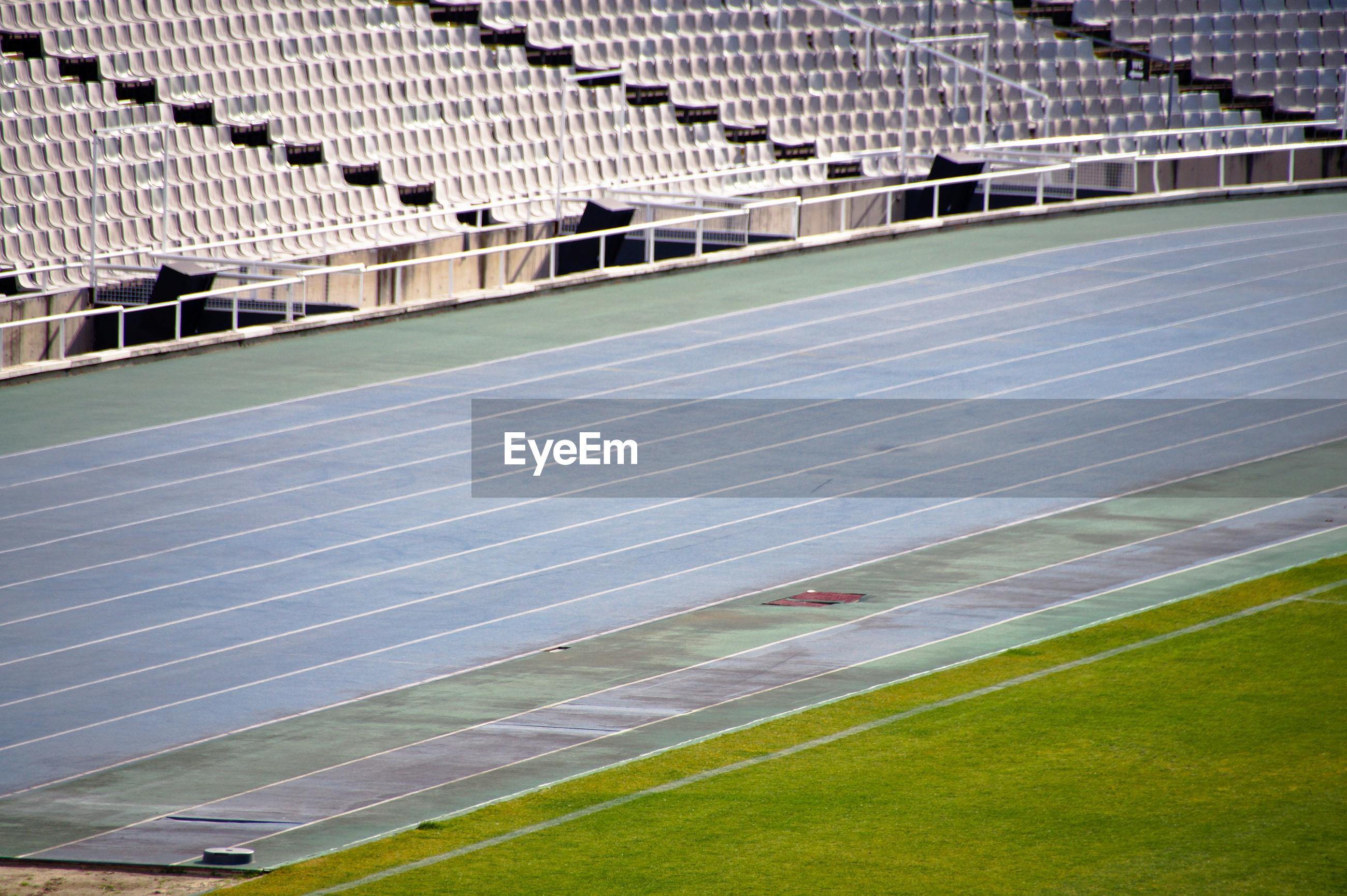 Scenic view of empty running track in stadium while corona