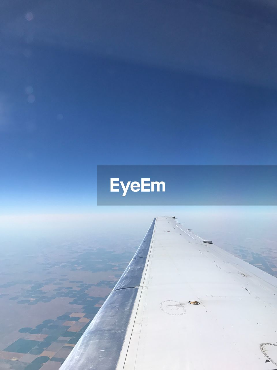 airplane, air vehicle, transportation, sky, flying, mode of transportation, aircraft wing, blue, no people, travel, nature, scenics - nature, mid-air, beauty in nature, aerial view, cloud - sky, day, copy space, on the move, outdoors, jet engine