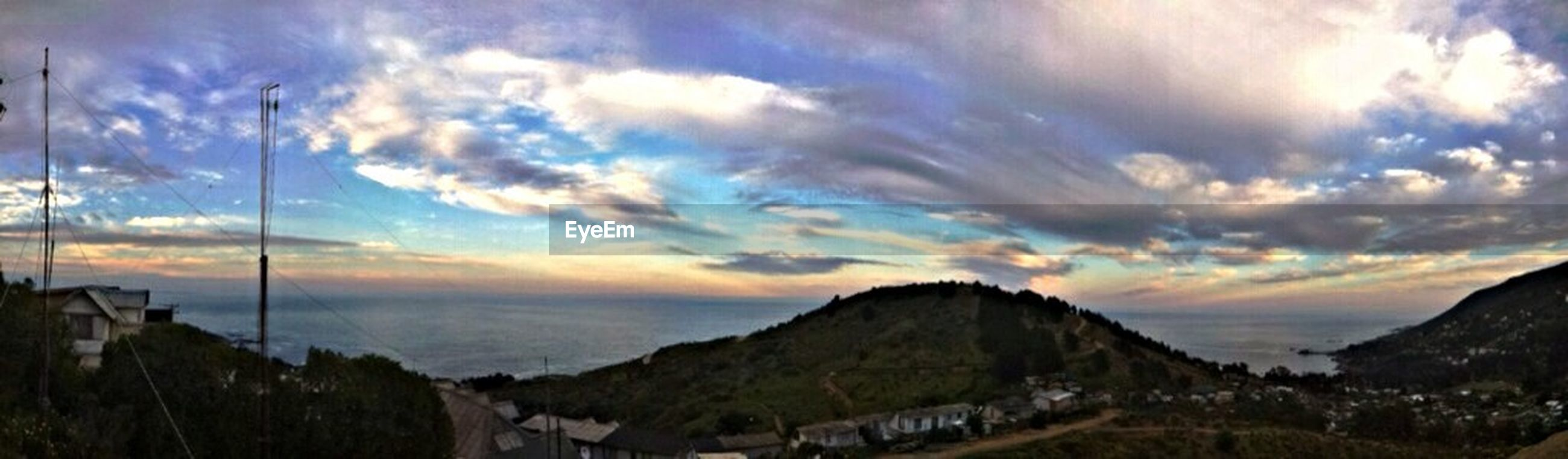 mountain, sky, cloud - sky, scenics, tranquil scene, beauty in nature, tranquility, cloudy, mountain range, sunset, landscape, cloud, nature, idyllic, non-urban scene, dramatic sky, panoramic, weather, outdoors, no people