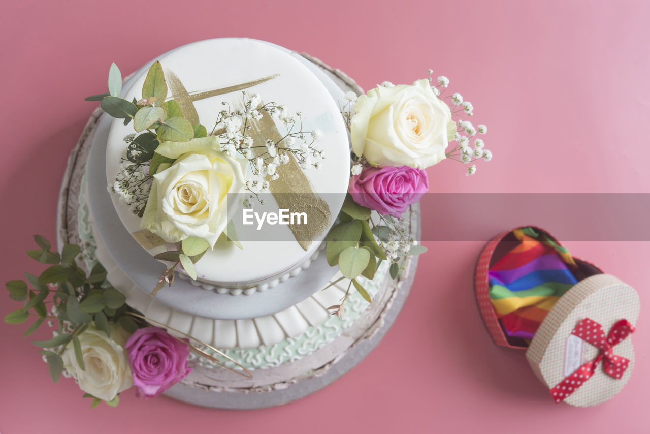 flower, plant, flowering plant, beauty in nature, rose, freshness, rose - flower, indoors, no people, still life, table, close-up, cake, nature, sweet food, vulnerability, sweet, dessert, food and drink, decoration, floral pattern, temptation, flower head, wedding cake, pearl jewelry, flower arrangement