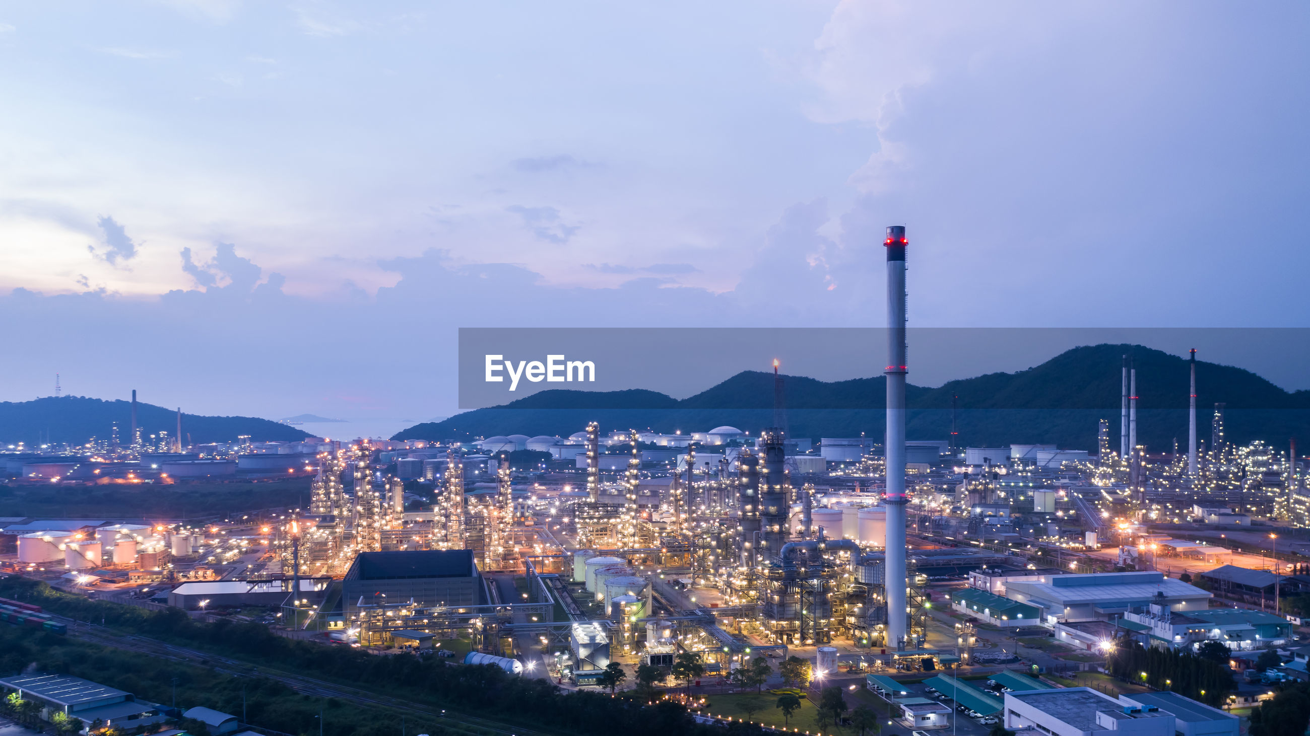 Twilight city and landscape view refinery oil and lpg in thailand aerial view from drone