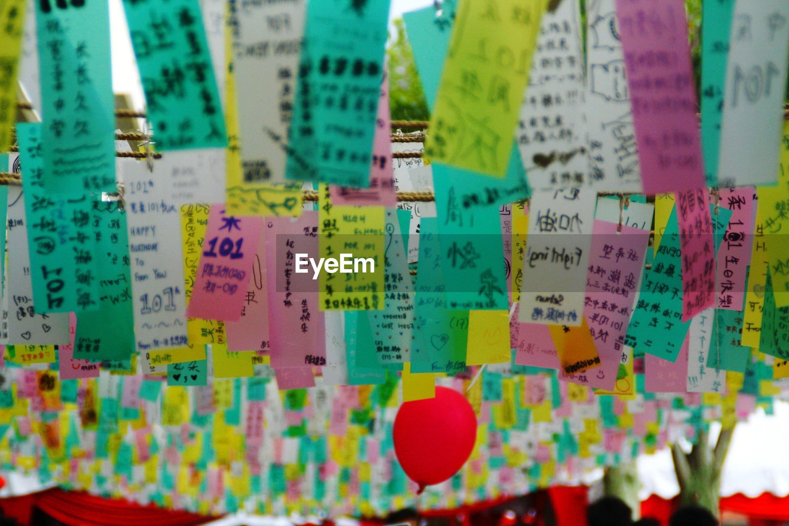 Close-up of notes hanging on string