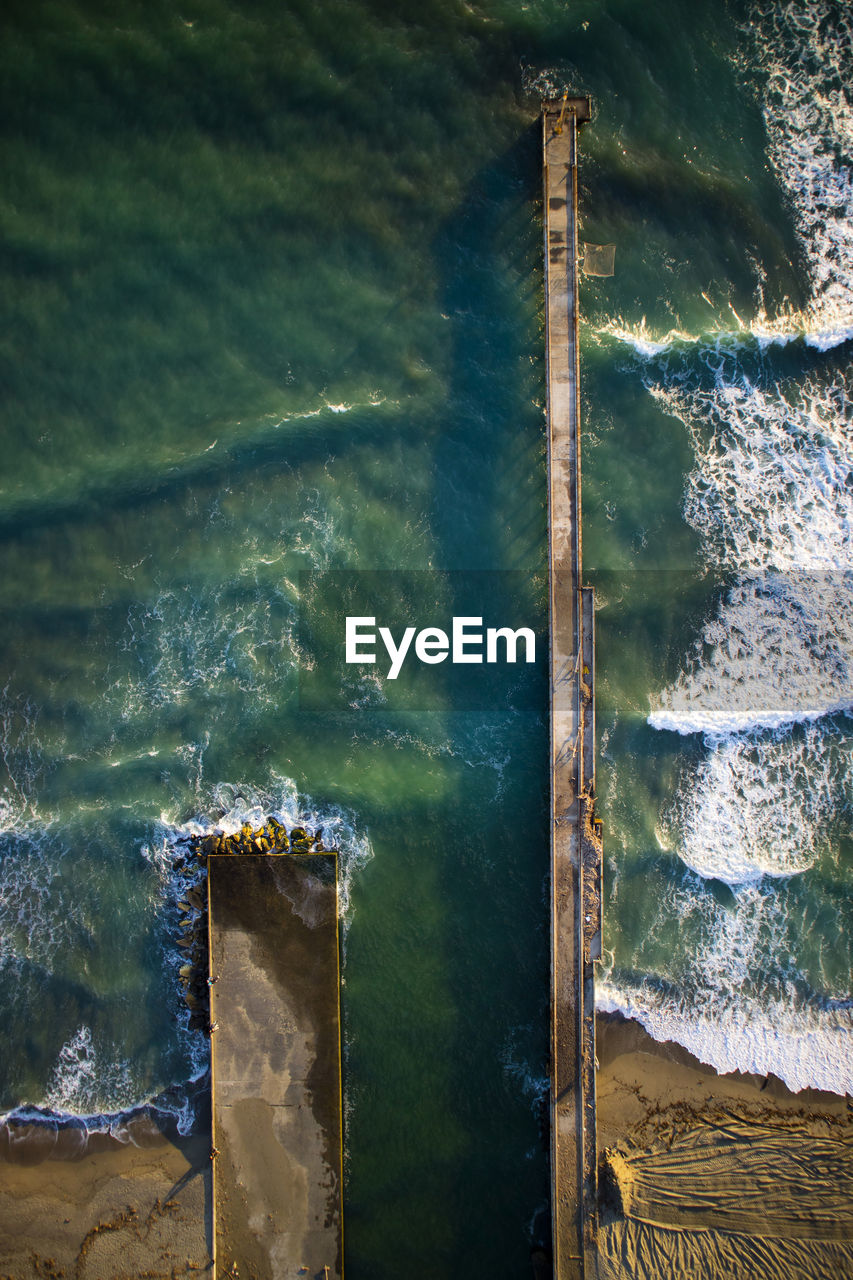 water, day, nature, no people, motion, sea, outdoors, close-up, high angle view, wood - material, architecture, built structure, wave, land, flowing water, sport, rock, rusty, flowing, breaking, wooden post