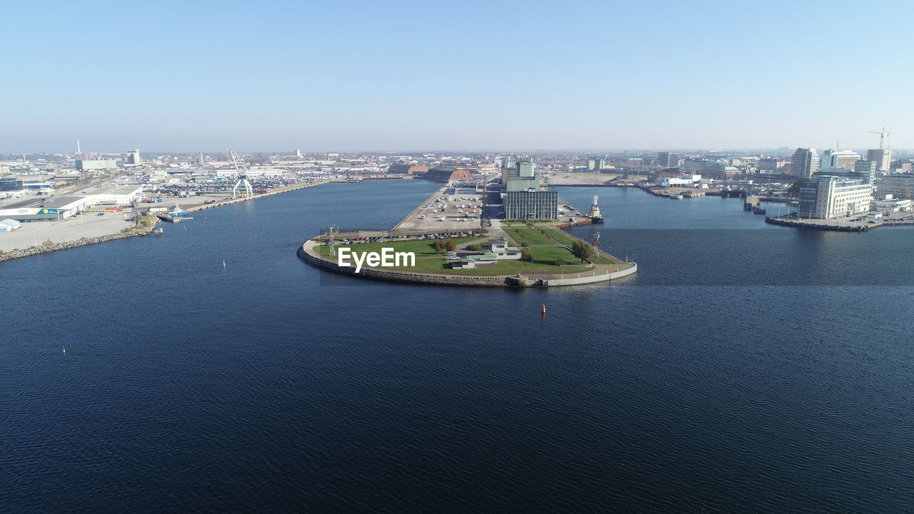 architecture, building exterior, city, built structure, water, transportation, sky, cityscape, nature, day, no people, building, high angle view, nautical vessel, waterfront, clear sky, river, travel destinations, outdoors, office building exterior, skyscraper