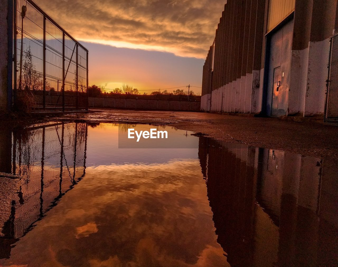 sunset, reflection, water, sky, architecture, built structure, cloud - sky, building exterior, no people, orange color, nature, building, waterfront, beauty in nature, outdoors, lake, house, scenics - nature, puddle