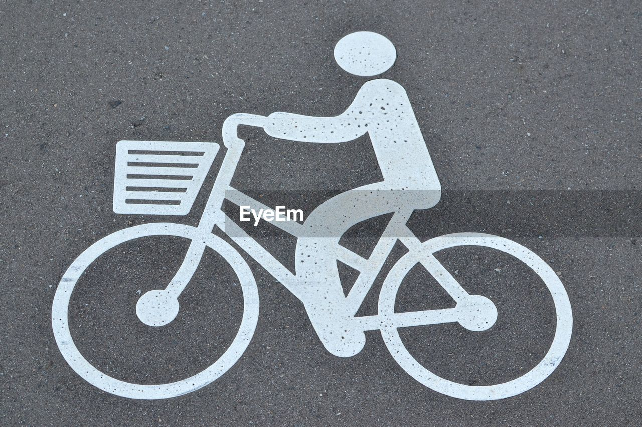 High angle view of bicycle sign on street