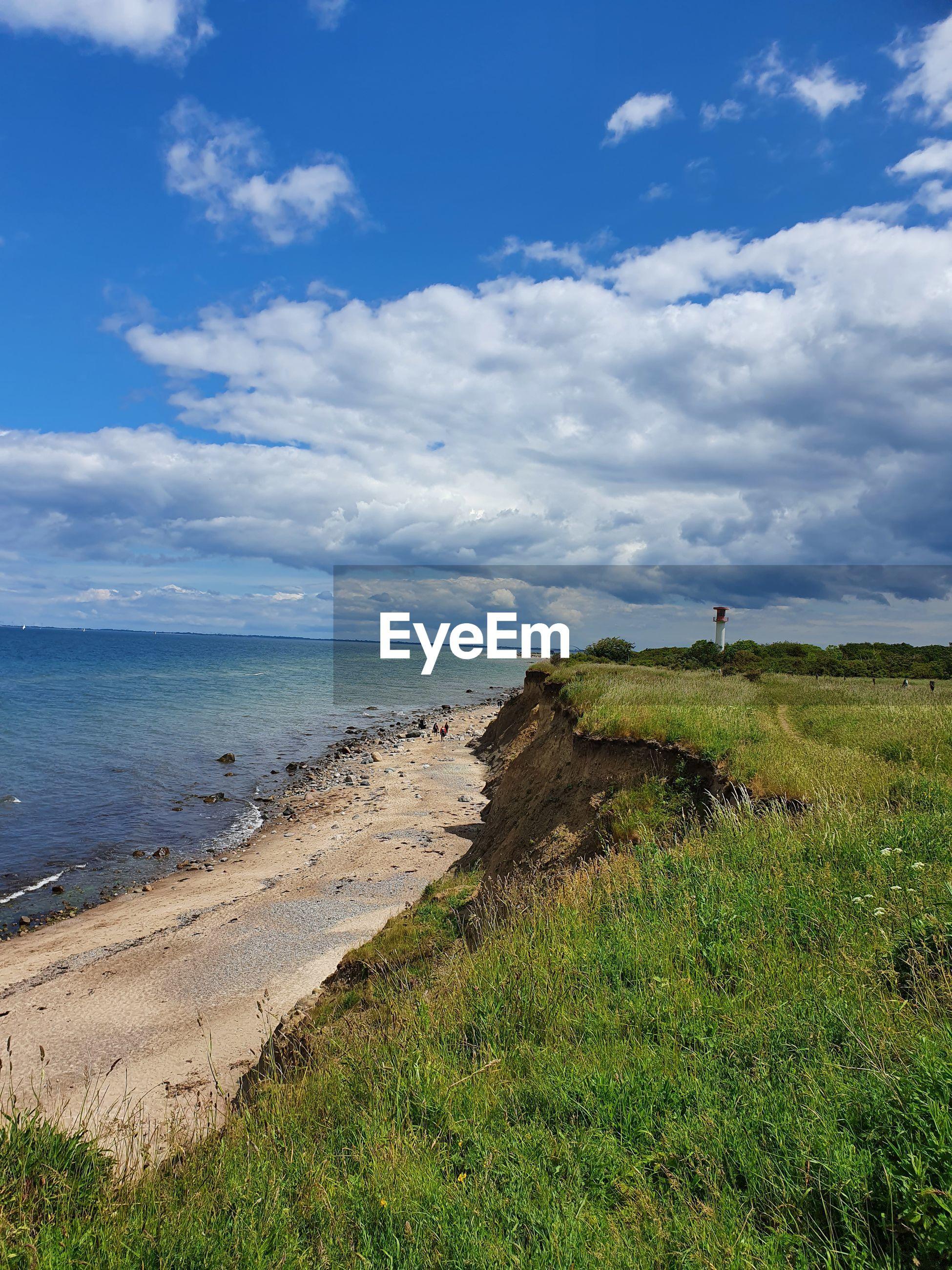 IDYLLIC VIEW OF BEACH AGAINST SKY