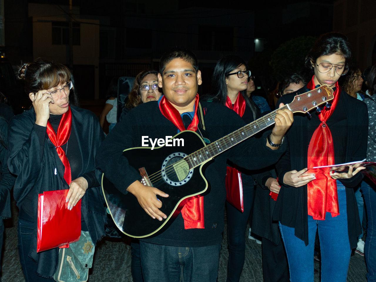 PEOPLE PLAYING GUITAR