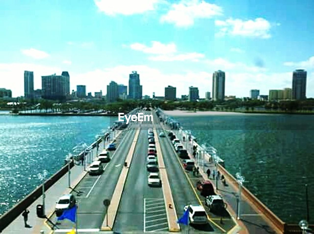 city, skyscraper, architecture, built structure, city life, urban skyline, modern, building exterior, day, cityscape, bridge - man made structure, river, downtown district, transportation, outdoors, nautical vessel, sky, travel destinations, water, people, adults only, adult