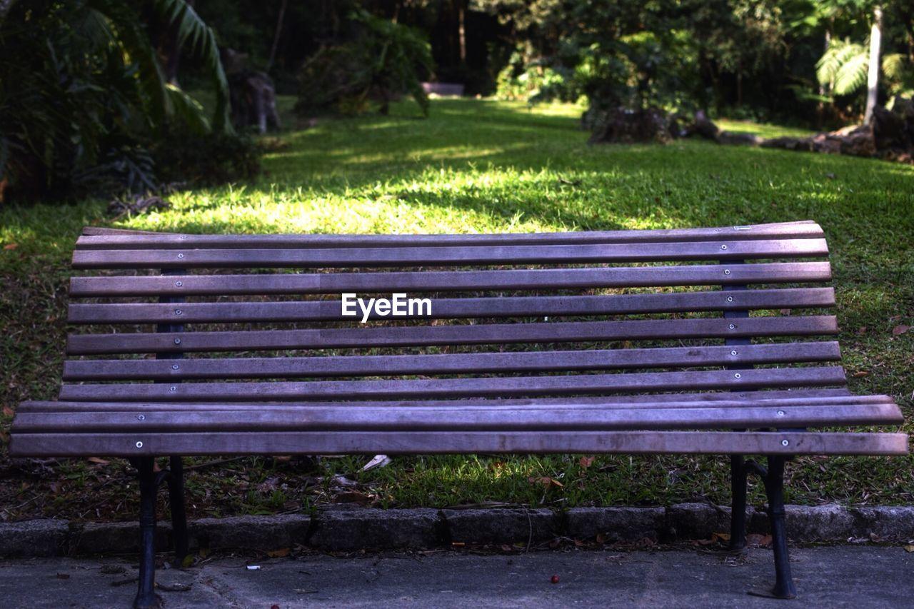 Empty purple bench in park