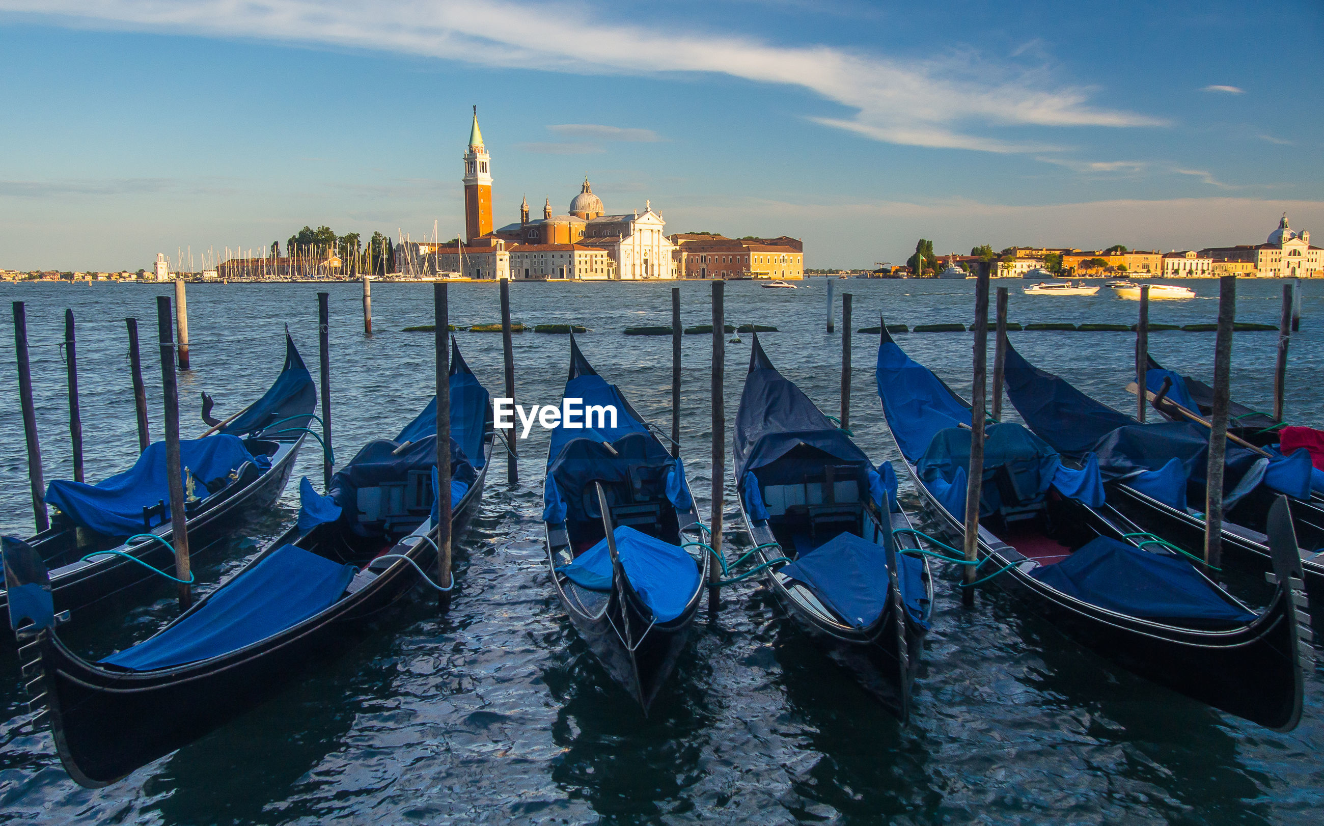 Gondolas moored in grand canal against doges palace