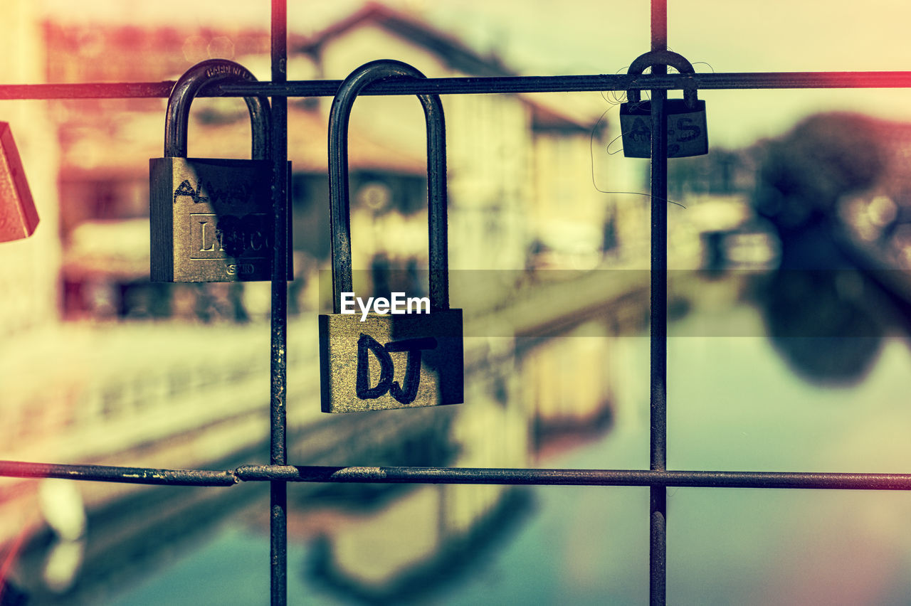 metal, safety, railing, focus on foreground, security, protection, day, close-up, selective focus, no people, outdoors, barrier, text, reflection, transportation, padlock, boundary, lock, glass - material