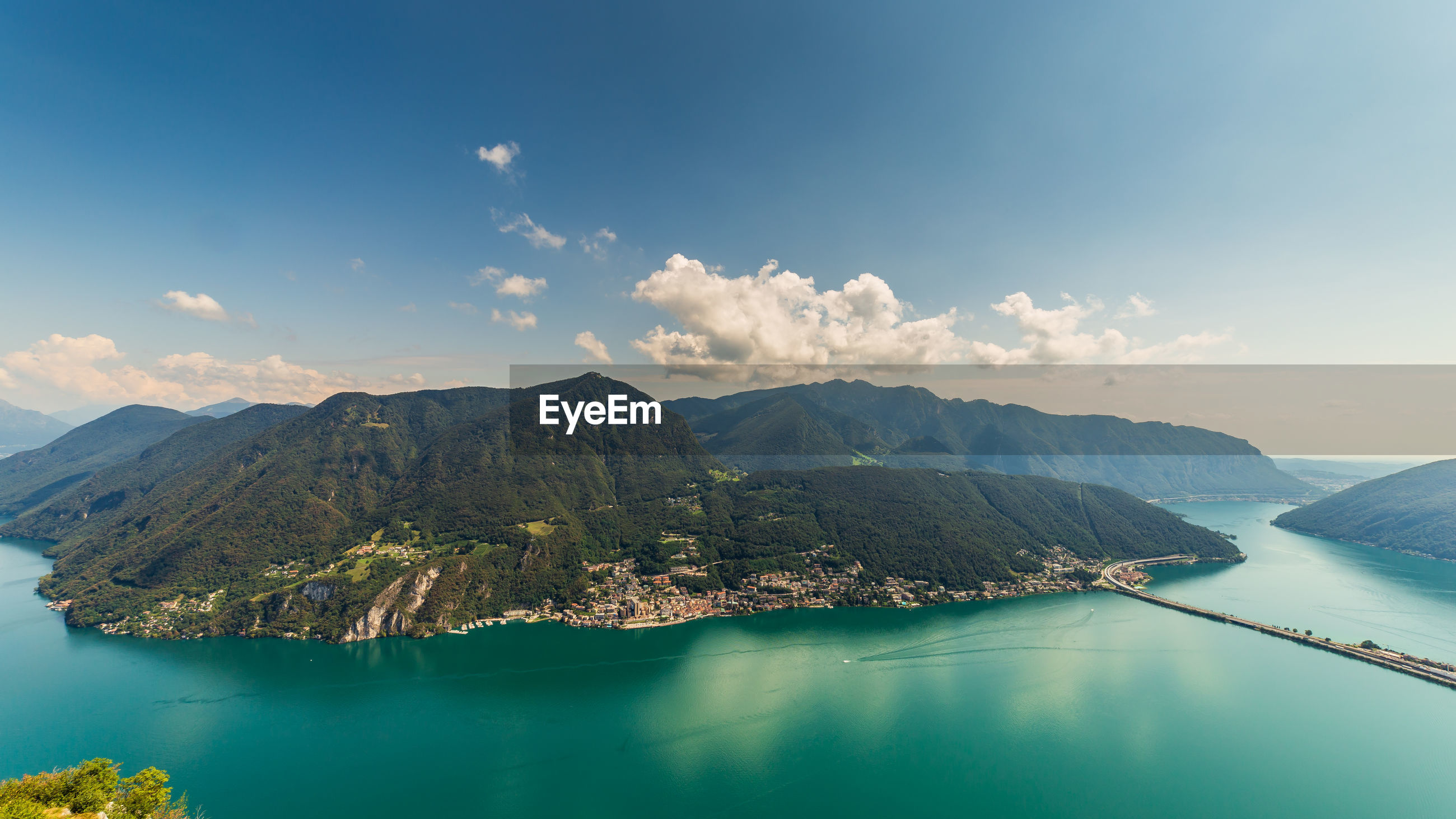 Panoramic view of bay against sky