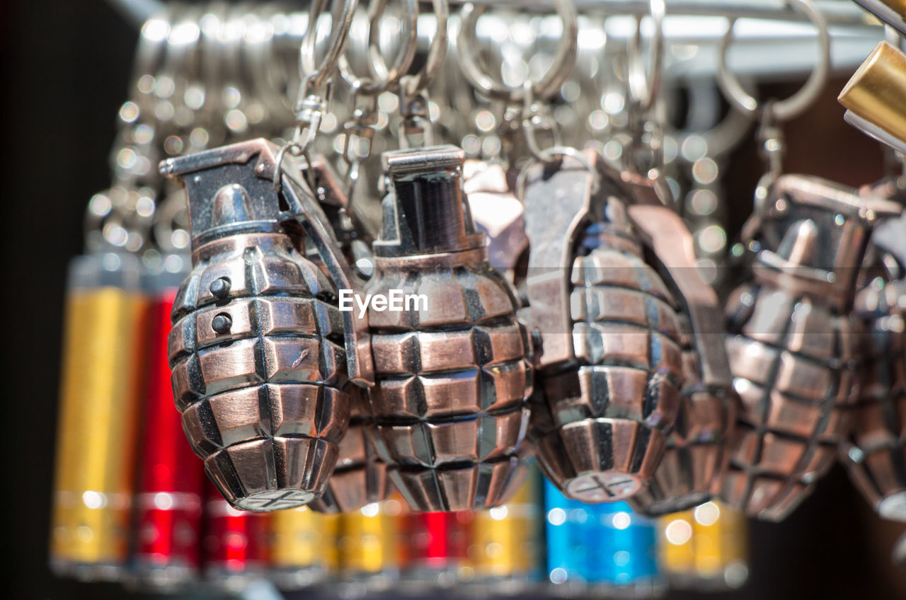 large group of objects, no people, still life, close-up, selective focus, hanging, variation, choice, metal, indoors, arrangement, for sale, focus on foreground, collection, retail, in a row, container, art and craft, order, side by side, sale