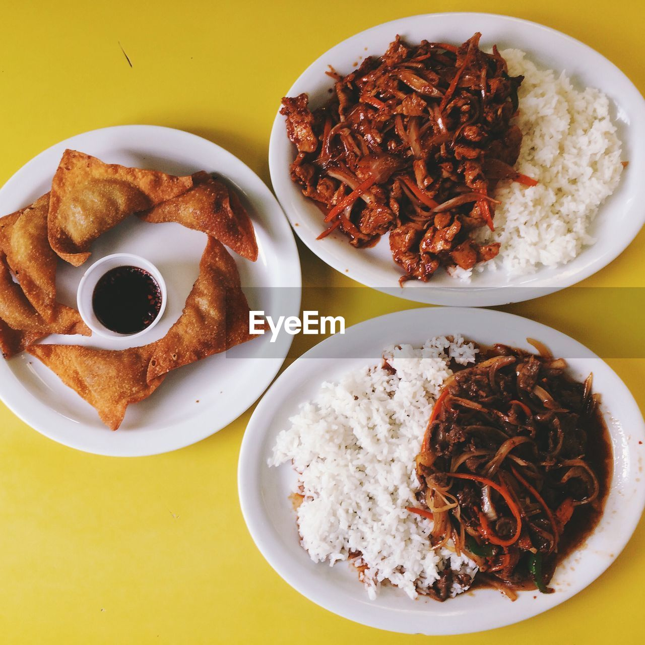 Korean Beef And Chicken Bulgogi Served On Plate