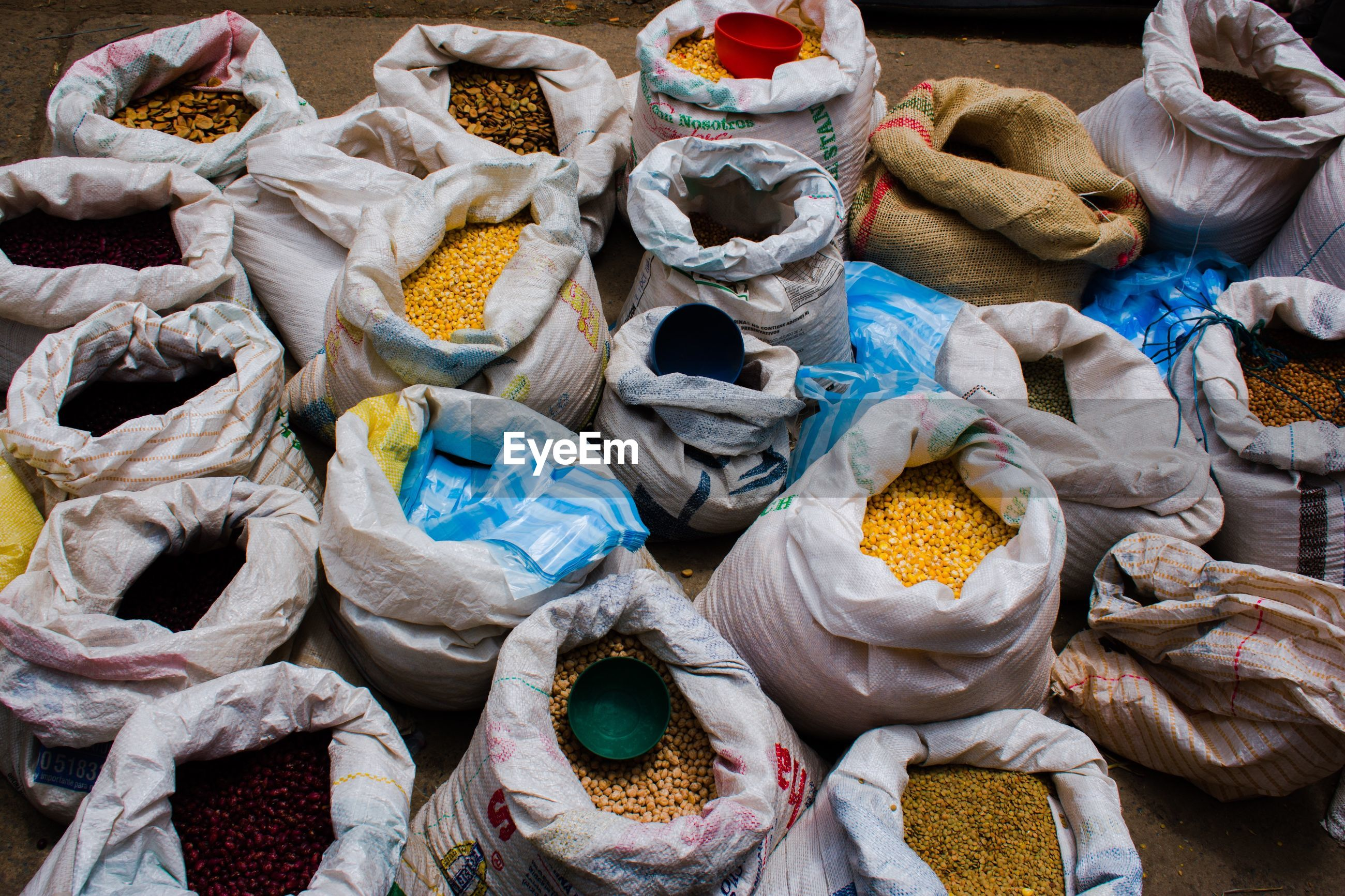 High angle view of various raw food in sack at market for sale