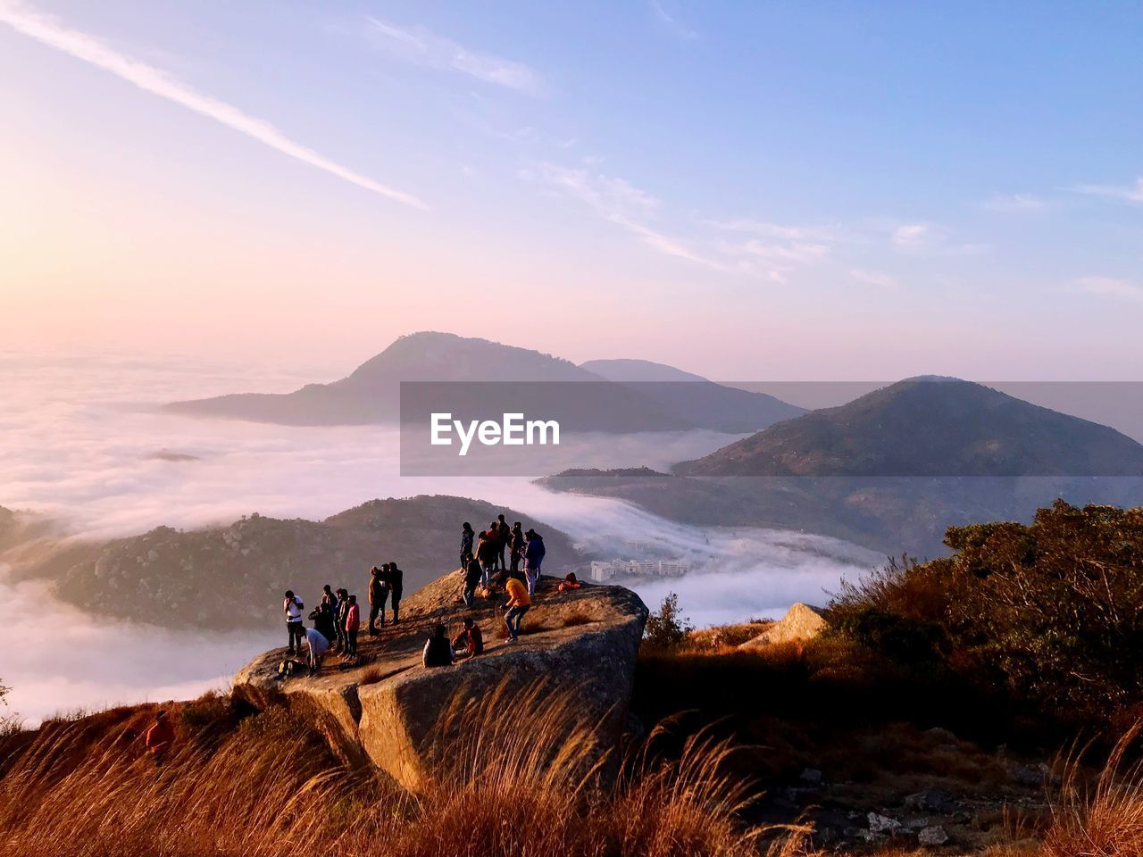 People By Cloudscape On Mountain During Sunrise