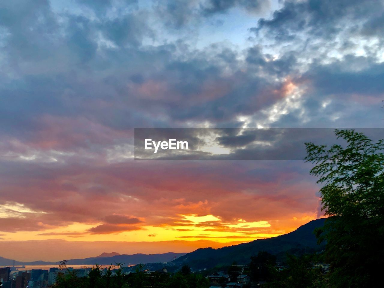 cloud - sky, sky, sunset, beauty in nature, scenics - nature, orange color, tranquil scene, tranquility, nature, tree, no people, idyllic, mountain, dramatic sky, plant, silhouette, outdoors, non-urban scene, environment, romantic sky