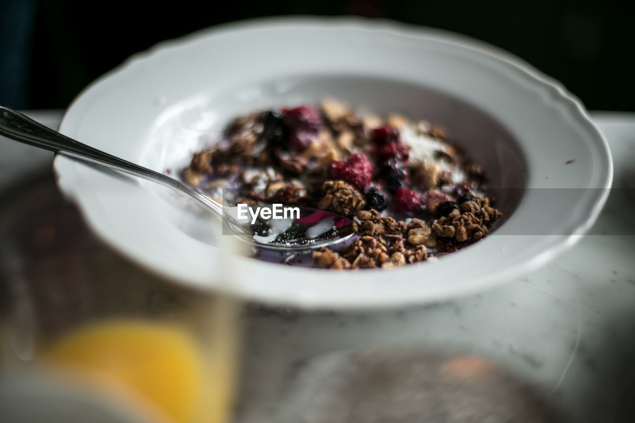 food and drink, food, eating utensil, kitchen utensil, selective focus, freshness, spoon, close-up, still life, indoors, healthy eating, wellbeing, table, meal, bowl, no people, breakfast, ready-to-eat, indulgence, breakfast cereal, temptation