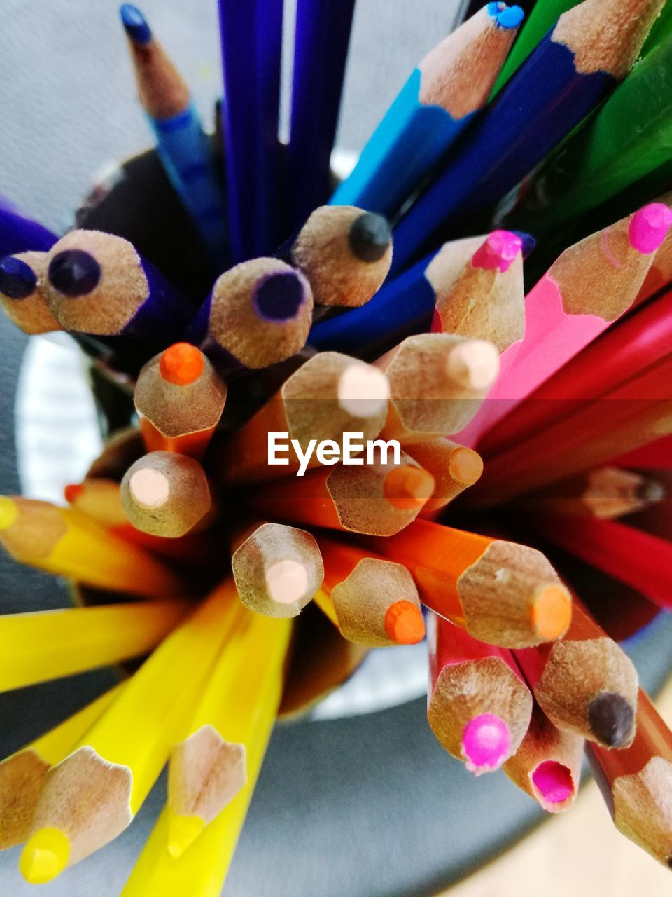 multi colored, pencil, writing instrument, large group of objects, choice, colored pencil, art and craft, variation, still life, close-up, no people, creativity, indoors, abundance, table, craft, selective focus, wood - material, focus on foreground, high angle view, art and craft equipment