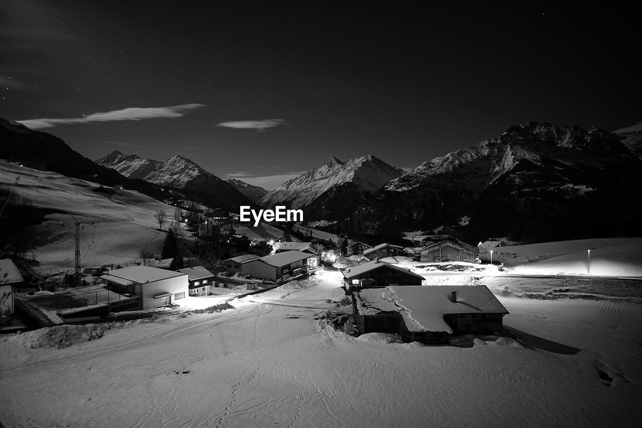 Snow Covered Land And Mountains Against Sky During Winter