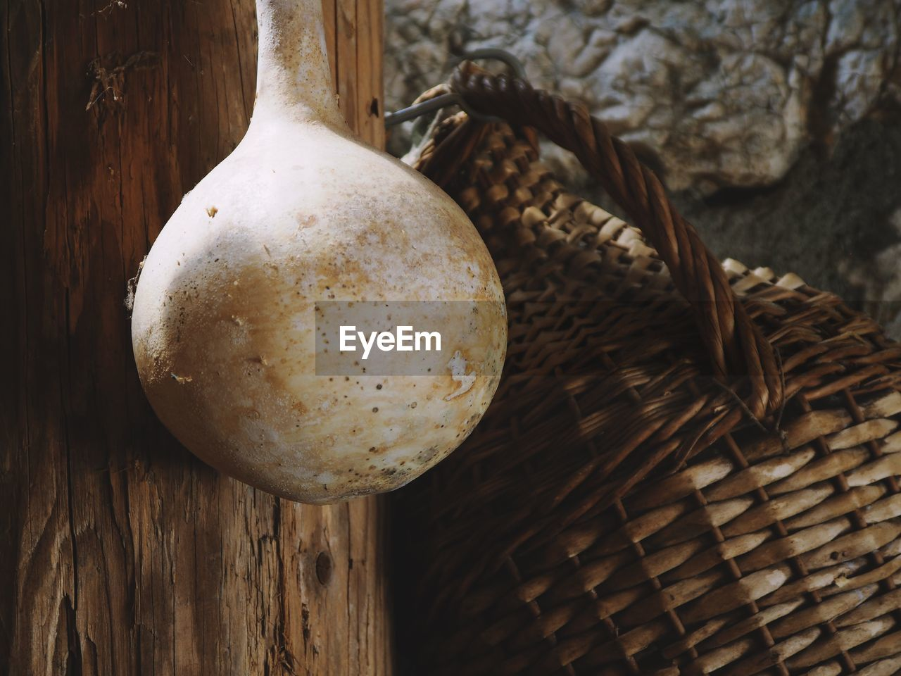 basket, no people, close-up, wood - material, container, still life, wicker, food, day, food and drink, art and craft, focus on foreground, indoors, hanging, brown, freshness, nature, high angle view, white color