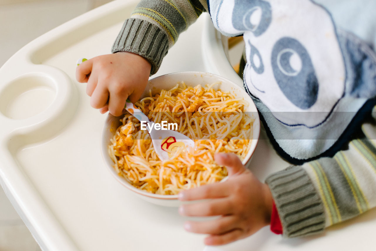 Close-Up Of Hands Of A Child Eating