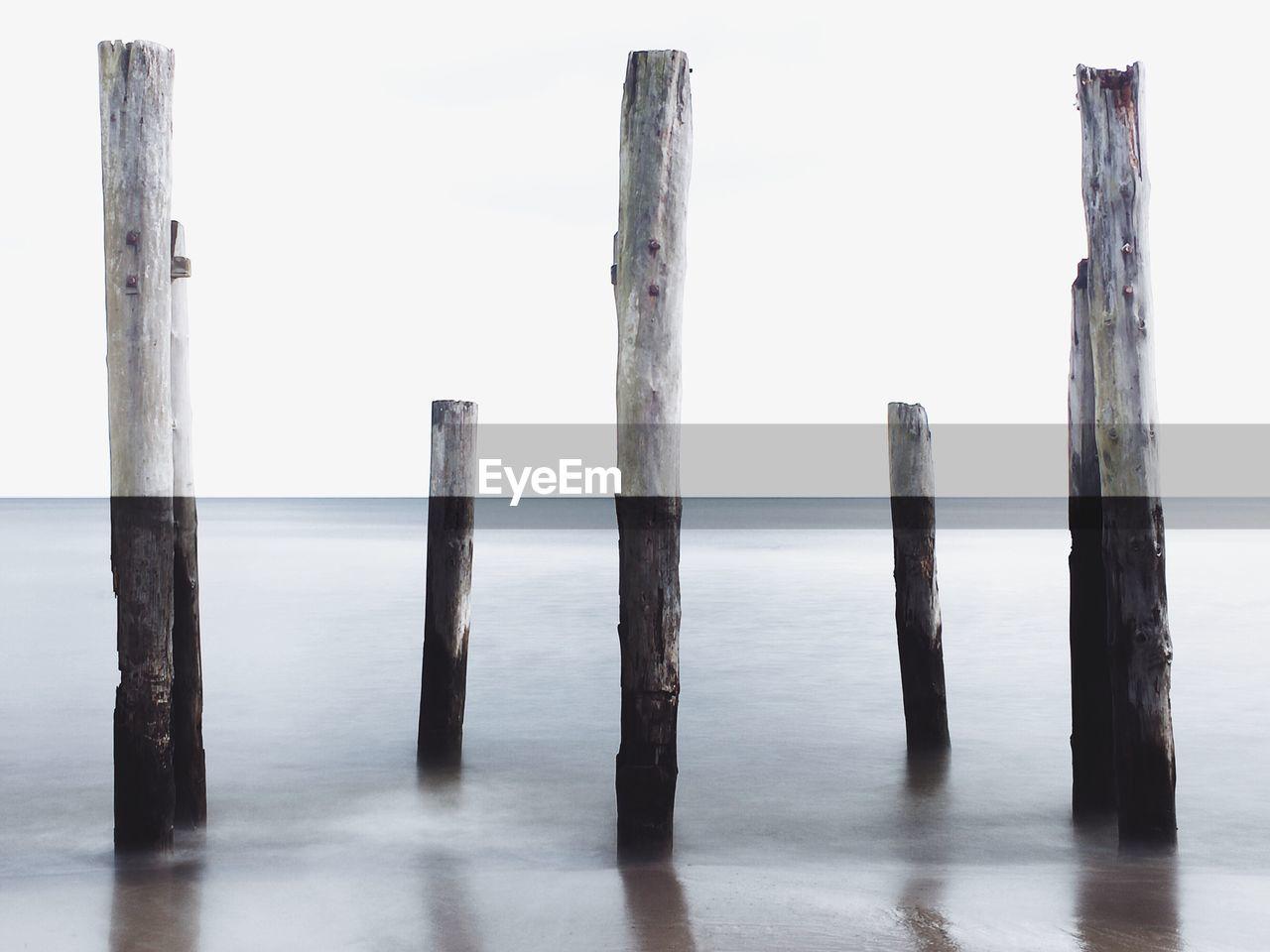 Wooden Post On Seashore At Beach