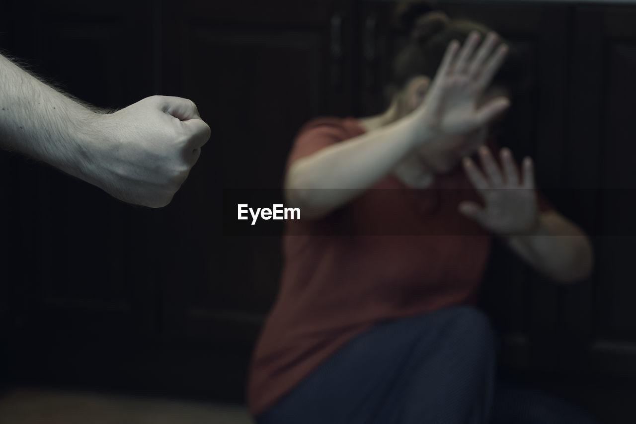 Man hitting woman in darkroom