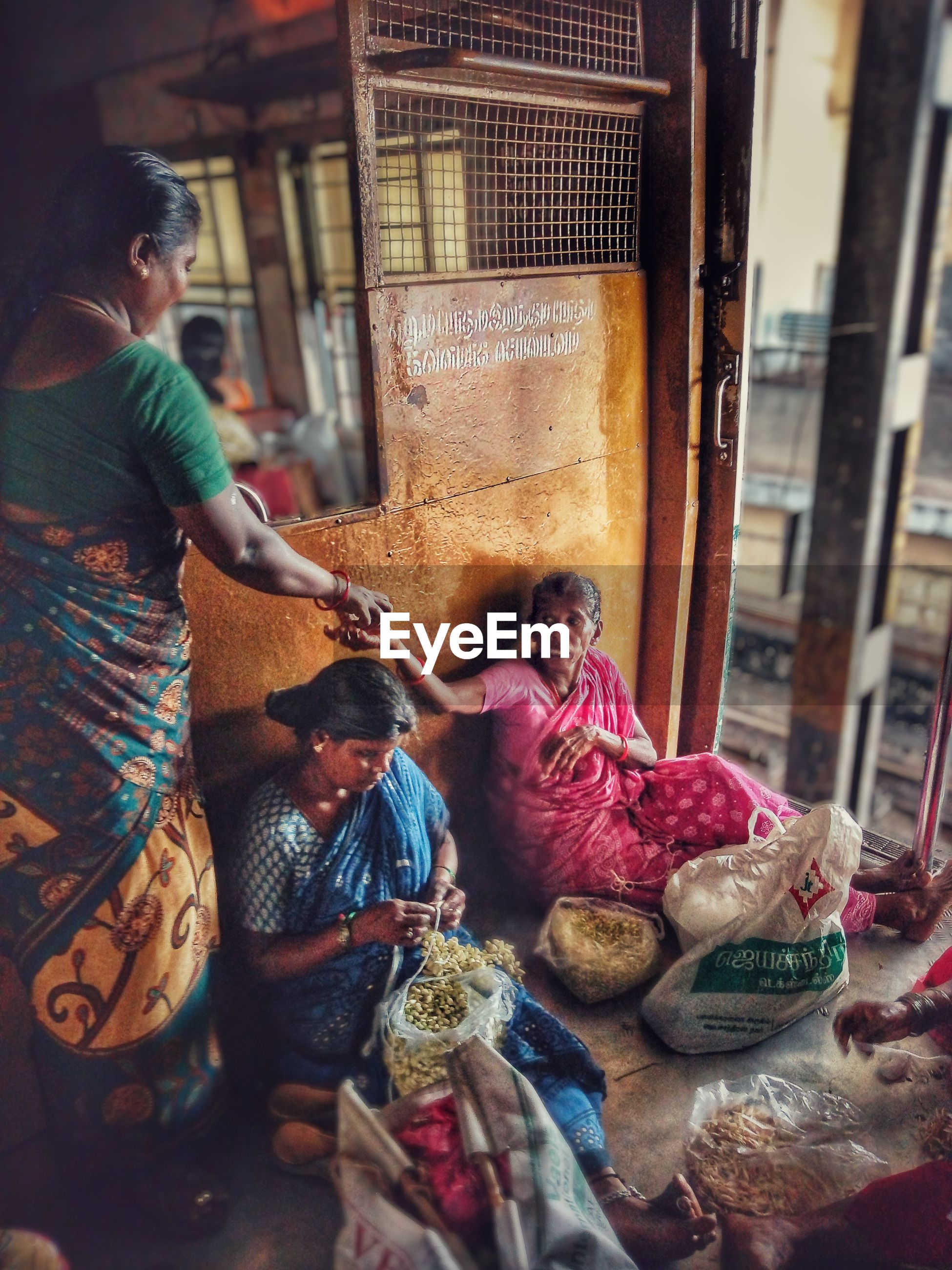 High angle view of women selling flowers in train