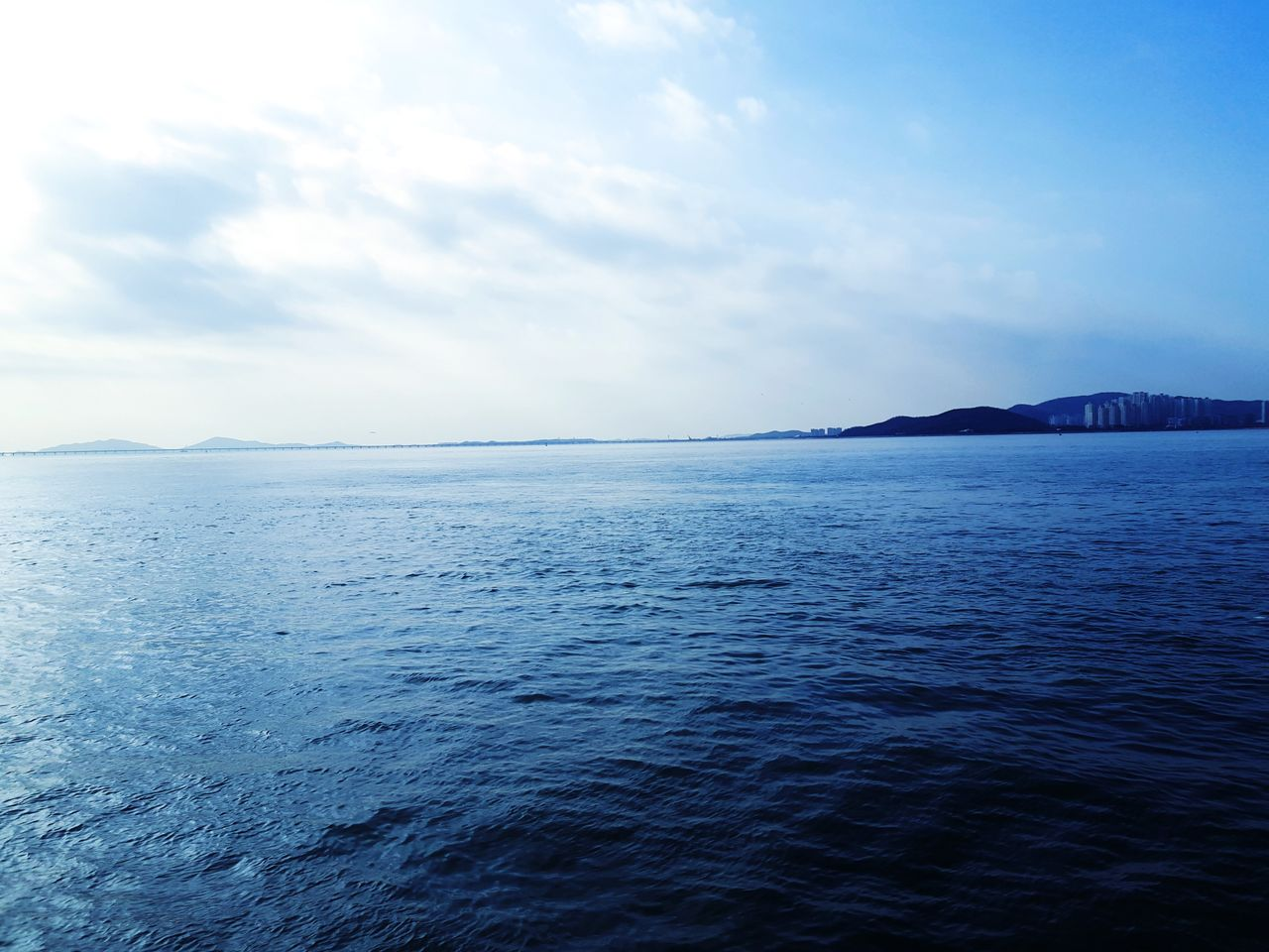 sky, water, sea, scenics - nature, beauty in nature, tranquil scene, waterfront, tranquility, cloud - sky, no people, idyllic, nature, blue, horizon, mountain, horizon over water, remote, day, outdoors