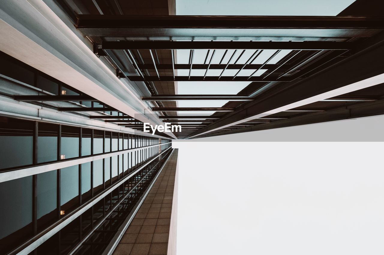architecture, built structure, indoors, no people, transportation, modern, railing, building, ceiling, day, glass - material, railroad station, direction, diminishing perspective, rail transportation, elevated walkway, low angle view, the way forward, office building exterior