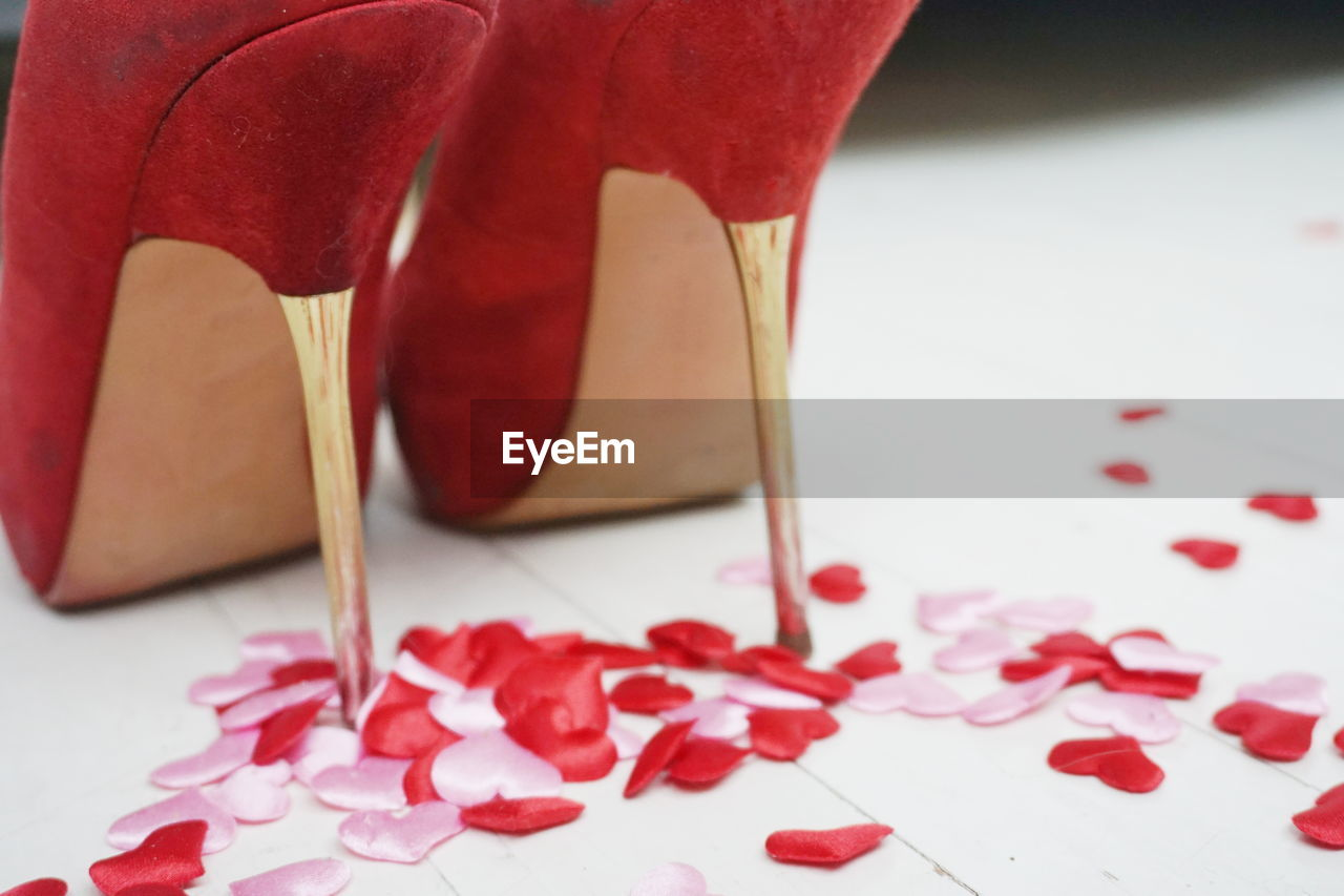 Stiletto and heart shape decorations on floor