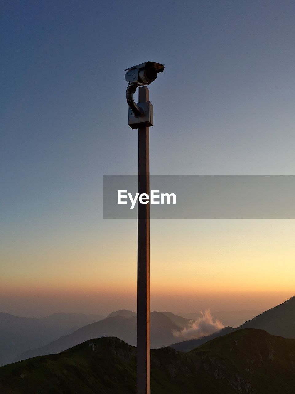 Security Camera Against Mountains During Sunset