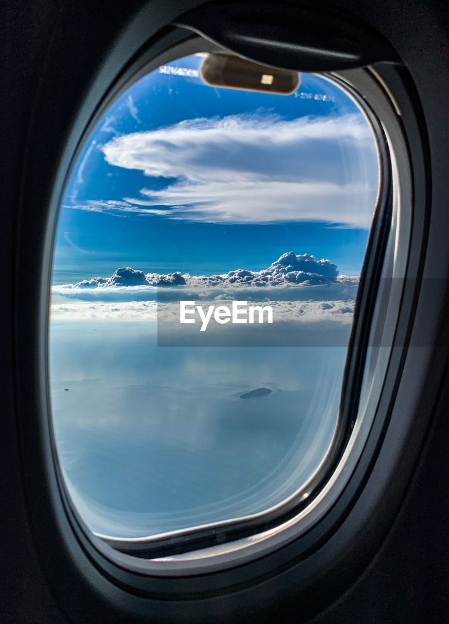 window, cloud - sky, sky, airplane, mode of transportation, air vehicle, transportation, vehicle interior, glass - material, transparent, beauty in nature, flying, nature, travel, scenics - nature, no people, mid-air, public transportation, day, outdoors