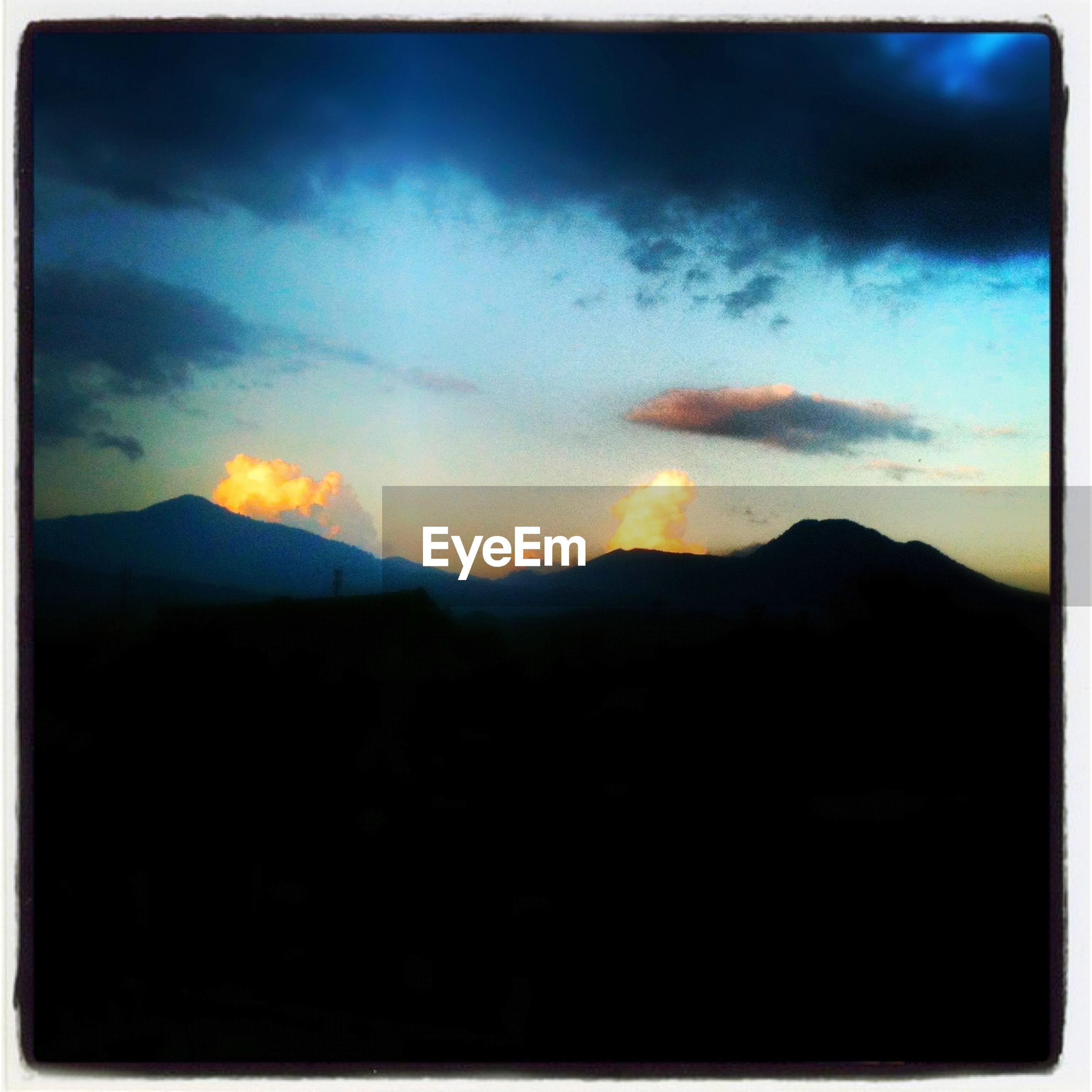 sunset, mountain, scenics, silhouette, sky, tranquil scene, beauty in nature, tranquility, mountain range, landscape, nature, idyllic, cloud - sky, sun, dark, cloud, orange color, majestic, dramatic sky, transfer print