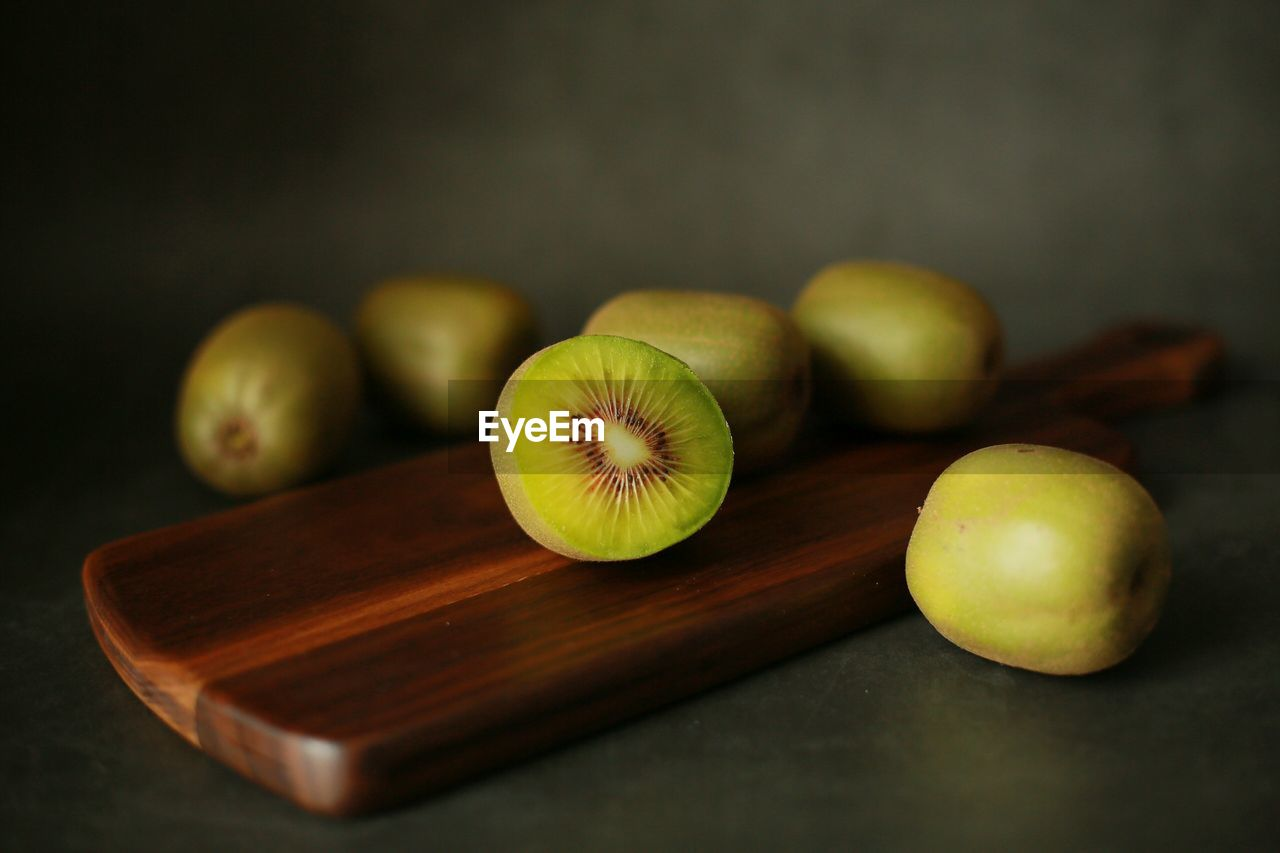 Close-Up Of Kiwis On Table