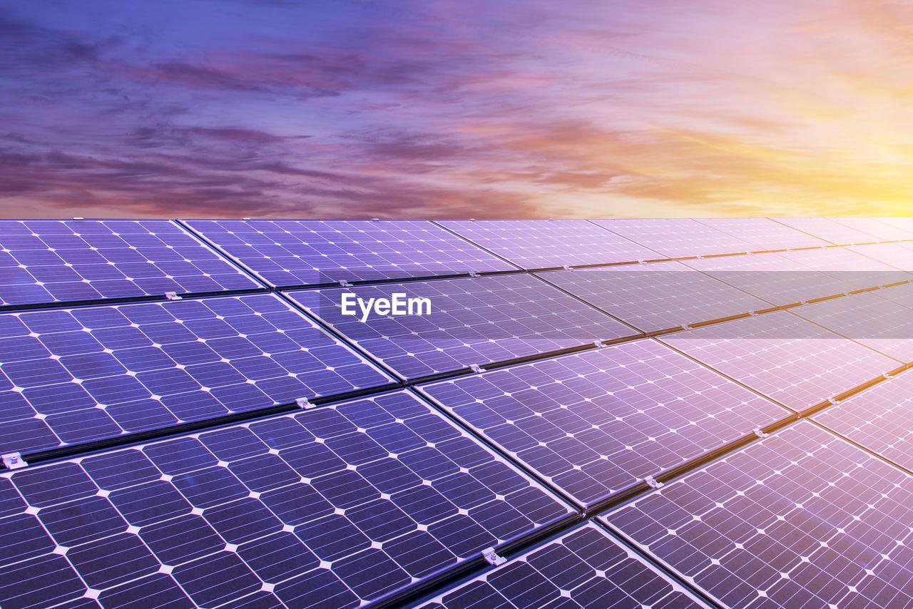 TILT IMAGE OF ELECTRICITY PYLON AGAINST SKY
