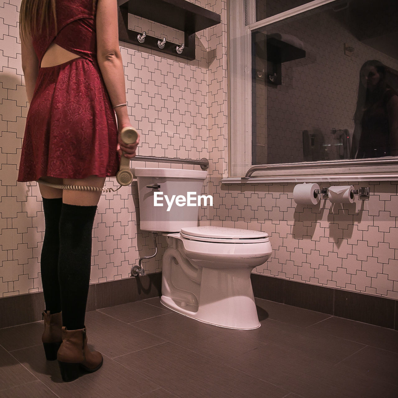 Low section of woman standing in bathroom