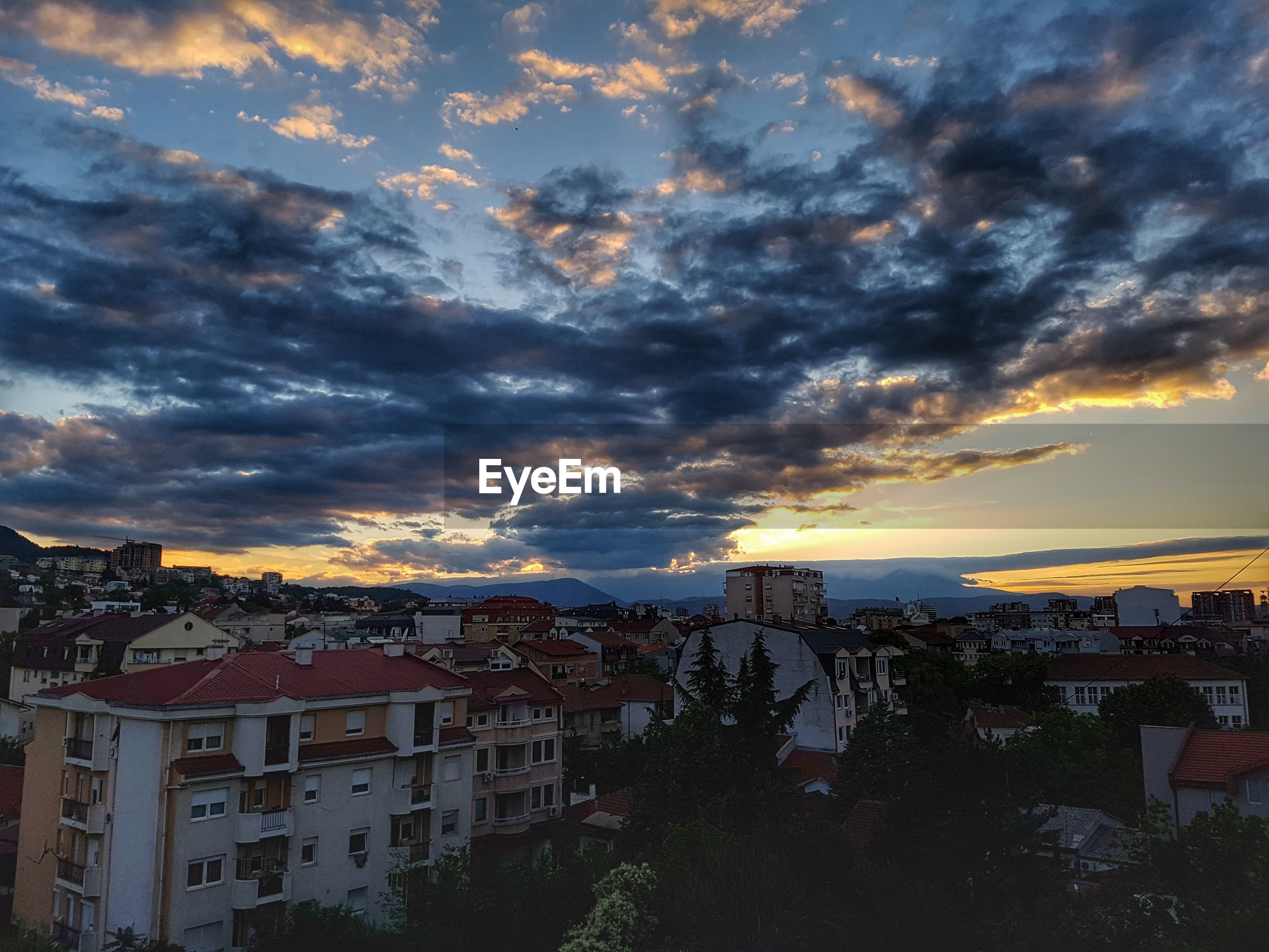 architecture, building exterior, built structure, sunset, sky, cloud - sky, no people, city, town, residential building, cityscape, outdoors, nature, beauty in nature, day