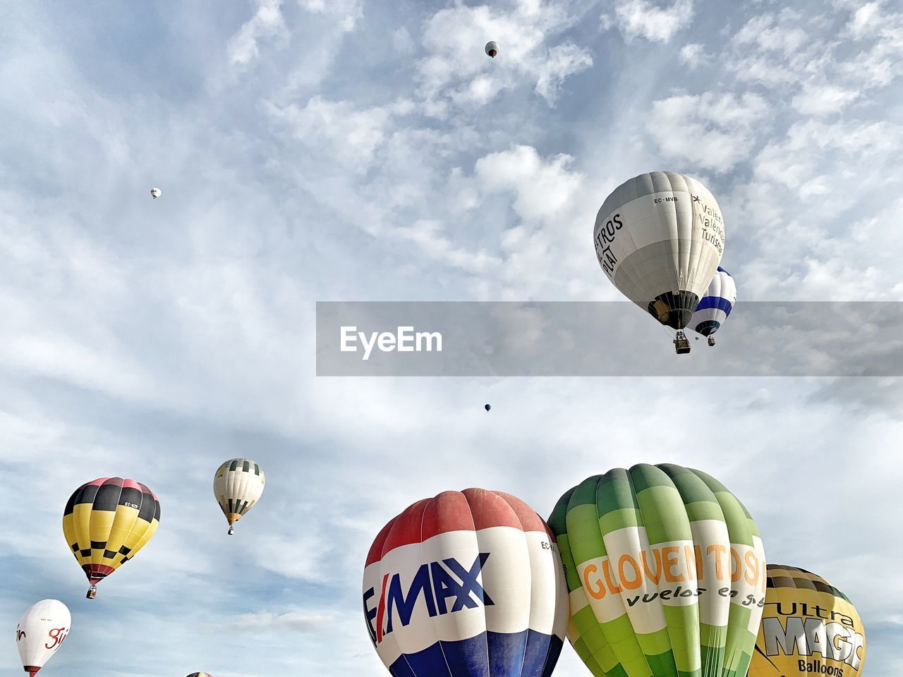 flying, hot air balloon, balloon, mid-air, air vehicle, transportation, sky, cloud - sky, multi colored, adventure, day, nature, ballooning festival, sport, parachute, low angle view, mode of transportation, extreme sports, outdoors, travel, parasailing