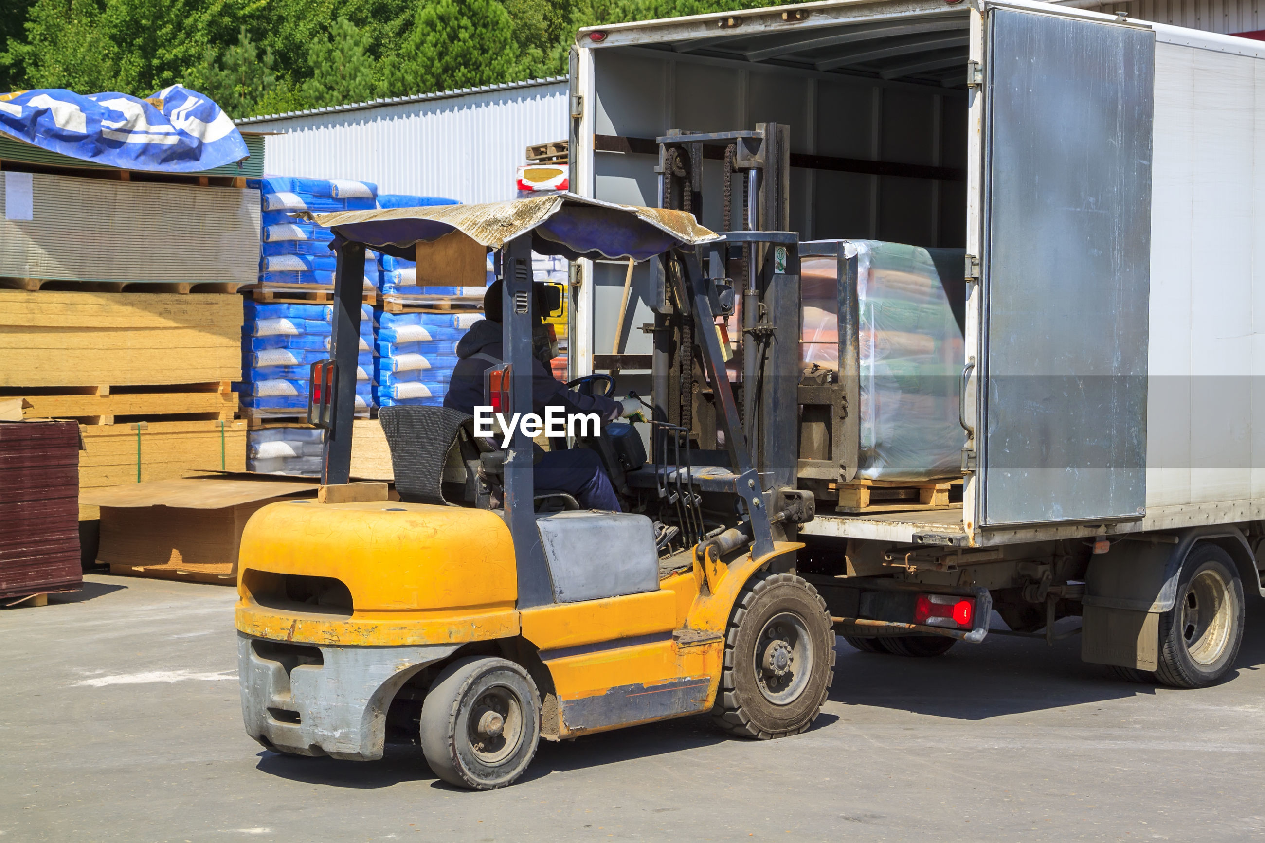 Man driving forklift outdoors