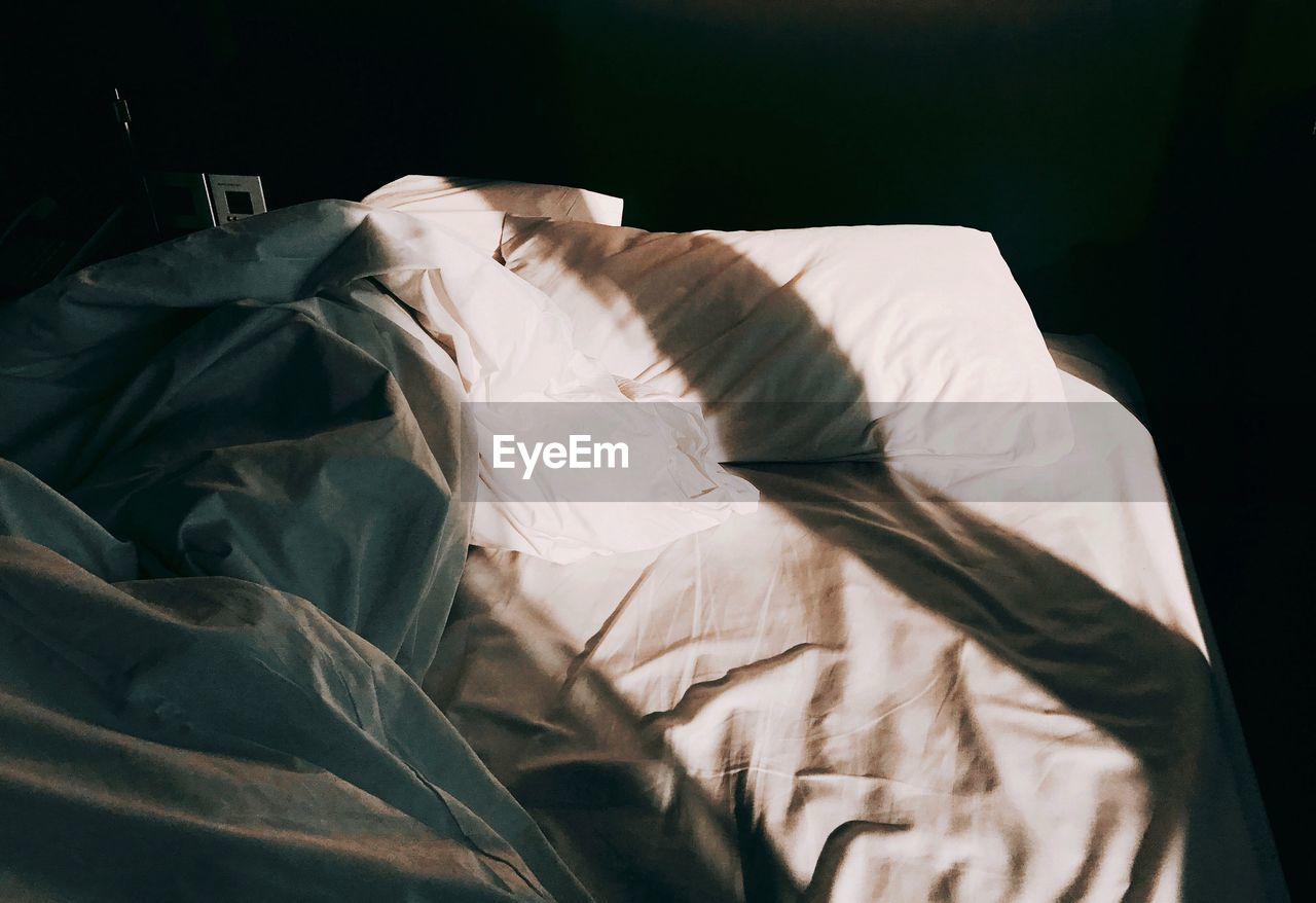 bed, furniture, indoors, textile, no people, crumpled, sheet, pillow, close-up, linen, sunlight, white color, home interior, domestic room, messy, absence, bedroom, comfortable, high angle view, still life, duvet
