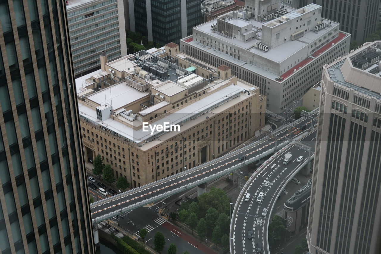 Aerial View Of Elevated Road Amidst Buildings In City