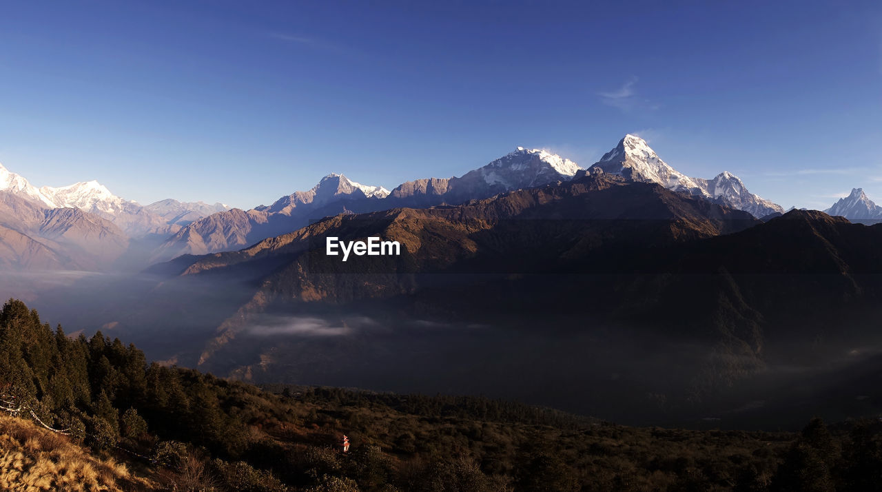 Panorama view of himalayan mountain range during sunrise view from poon hill view point at nepal