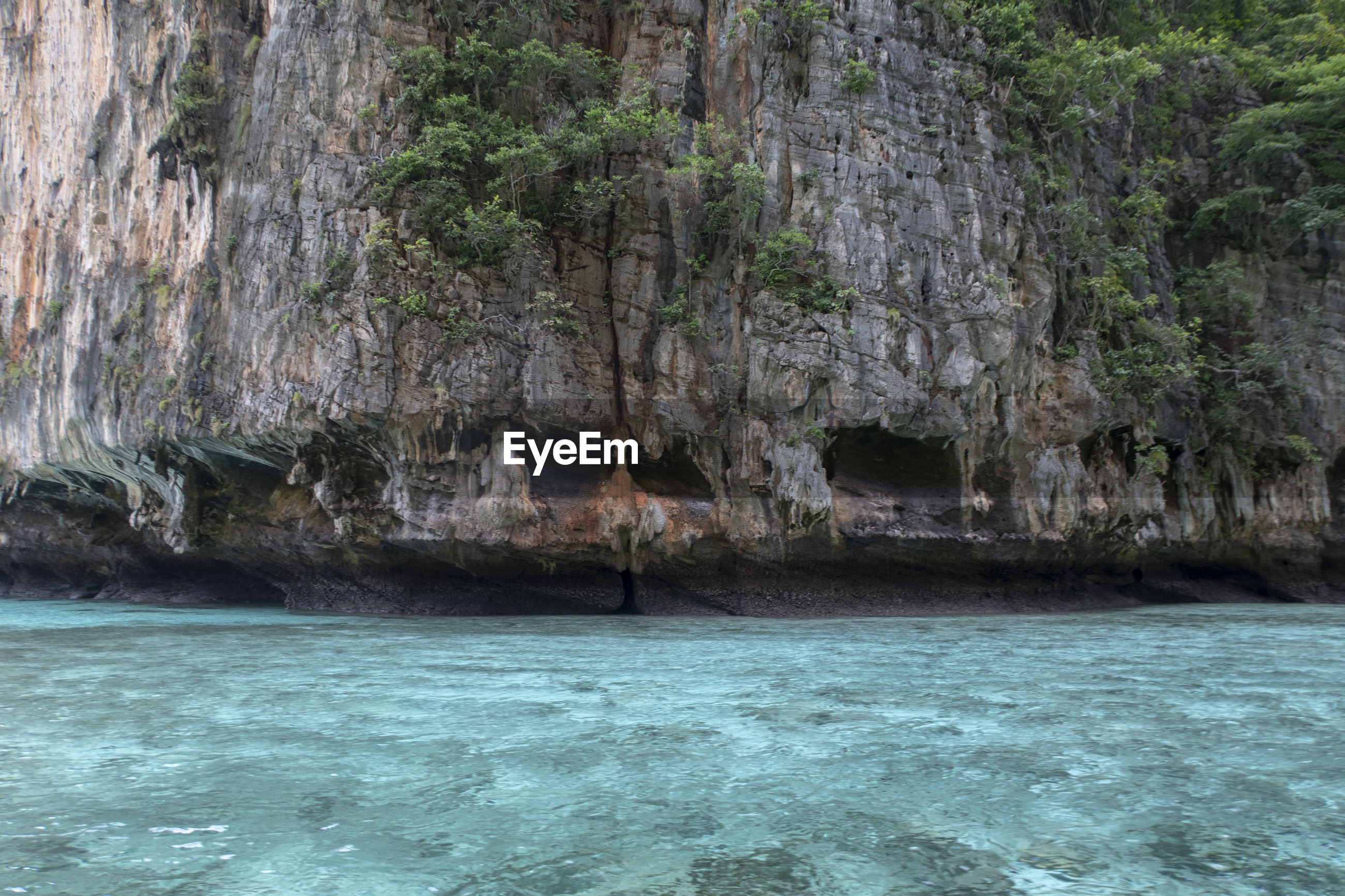 SCENIC VIEW OF ROCK FORMATION BY SEA