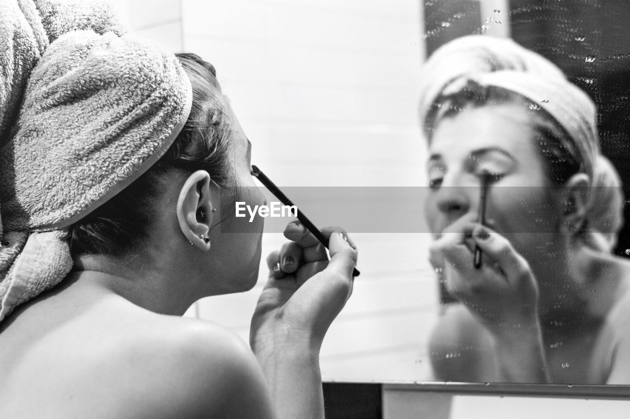 applying, beauty, make-up, headshot, real people, mirror, lifestyles, young adult, fashion, portrait, adult, beauty product, reflection, women, two people, body care, indoors, people, human body part, young women, make-up brush, beautiful woman, human face, preparation