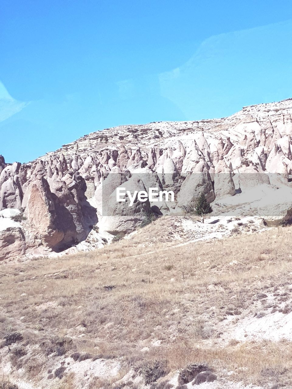 sky, beauty in nature, nature, tranquil scene, day, scenics - nature, rock, tranquility, blue, environment, no people, mountain, landscape, rock - object, rock formation, sunlight, non-urban scene, solid, land, outdoors, formation, arid climate, eroded