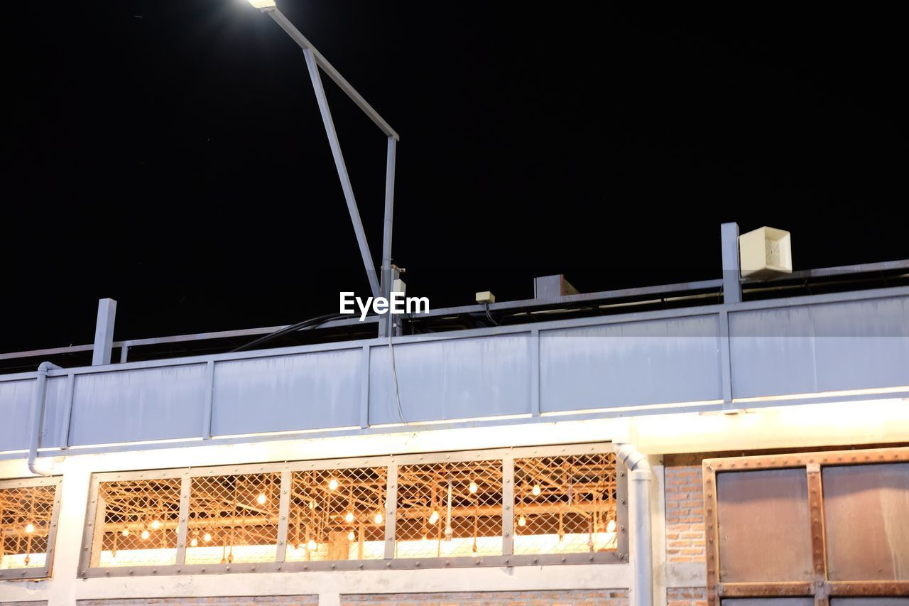 night, illuminated, train - vehicle, low angle view, no people, transportation, outdoors, sky