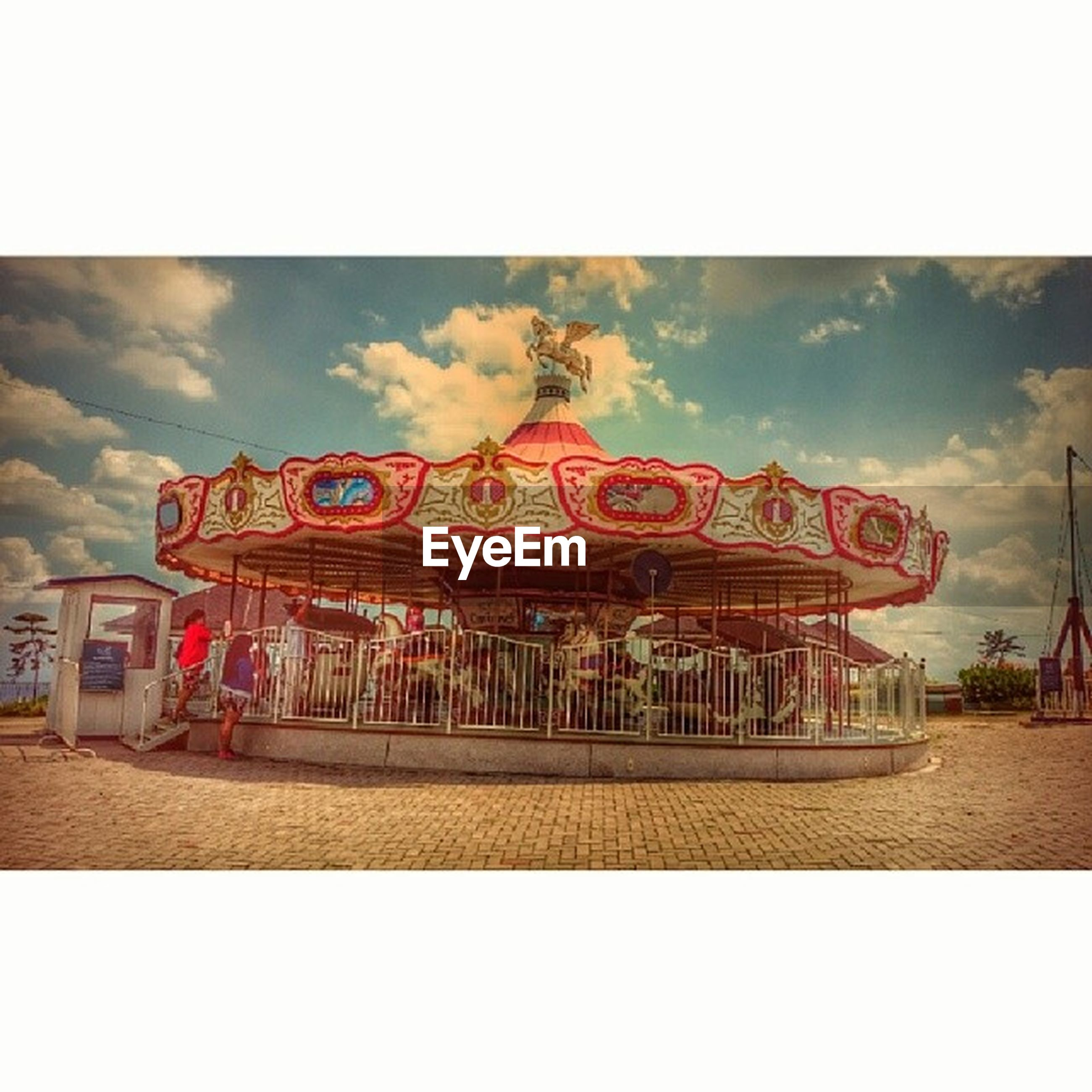 transfer print, auto post production filter, sky, built structure, architecture, text, western script, cloud - sky, building exterior, outdoors, cloud, day, communication, incidental people, red, men, non-western script, travel destinations, cloudy
